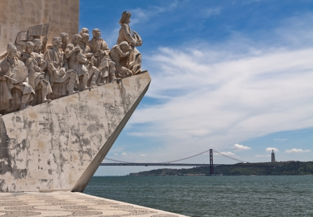 Fragment of Monument to Discoveries  Padrao dos Descobrimentos  with 25th of April bridge on background, Lisbon, Portugal