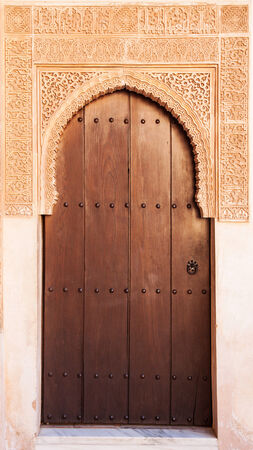A wooden door in Alhambra palace, Granada, Andalusia, Spain