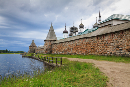 Holy Lake in front of the wall of Solovetsky monastery