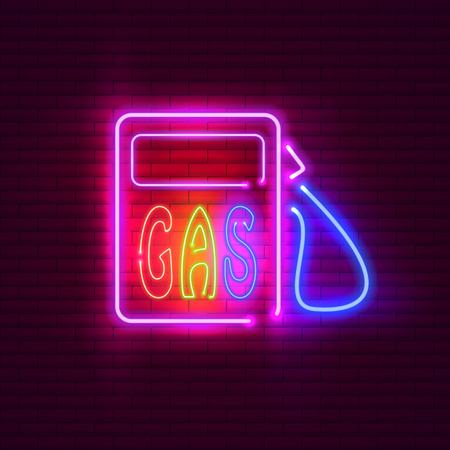 Gas station neon sign on brick wall. Vintage signboard