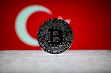 Physical silver version of Bitcoin BTC and Turkey Flag on the background. Conceptual image for investors in cryptocurrency and Blockchain . Фото со стока