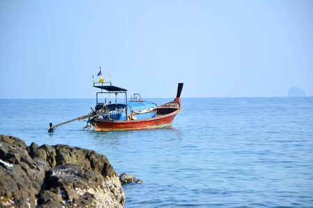 sea fishing: fishing boat in the sea with blue sky Stock Photo