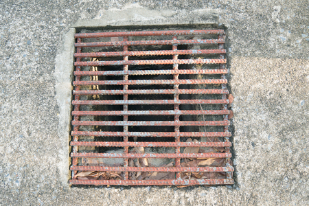 manhole cover: sewer manhole cover in a city street