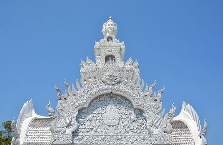 Traditional Thai style art of stucco on the roof of Pillar, Nan province, Thailand