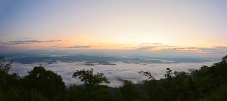 shifting: Panorama mountain view at sun rising with mist in the field (selective focus and white balance shifting applied) Stock Photo