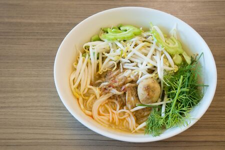 """thai rice vermicelli name """"Khanom chin"""" thai food with curry and vegetable"""