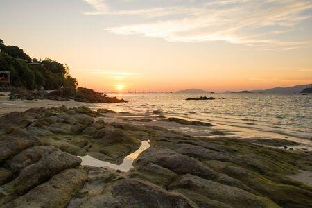 Beautiful sunset with sky over calm sea in tropical lipe island ,satun Thailand