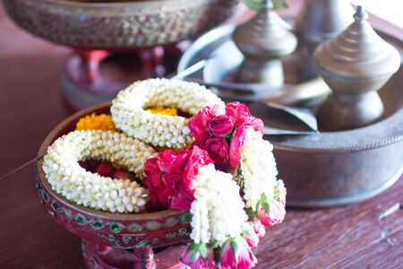 Thai traditional flower garlands known as Phuang Malai. They are made by various flower combinations usually jasmine buds ,orchid ,crown flowers and roses. Zdjęcie Seryjne