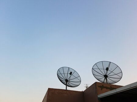 Two Antenna communication satellite dish on top of the building in urban area