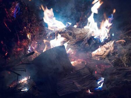 the bonfire burns the fire with a blue flame the heat energy is heat is dangerous Stock Photo