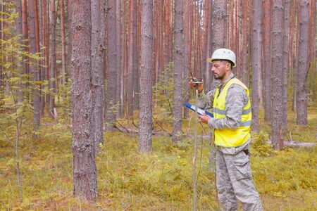 Forest engineer performs forest taxation. Forestry and forestry. Real people work. Stok Fotoğraf