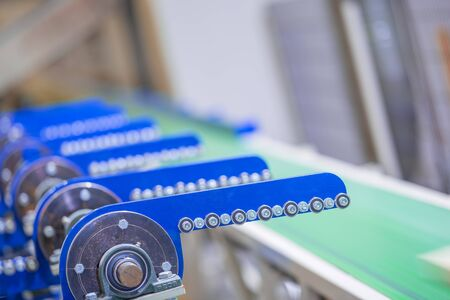 Conveyor belt. The mechanism of the automatic line. Automated industrial production.