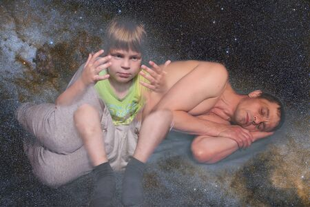 A 40-year-old European man lies and sleeps. Gray background. A 5 year old boy looks at his hands. The concept of entering the astral world. Collage on the theme of lucid dreams.