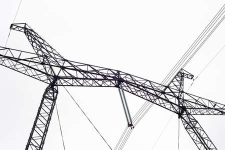 High-voltage transmission line of electrical energy. Metal structure, wires.