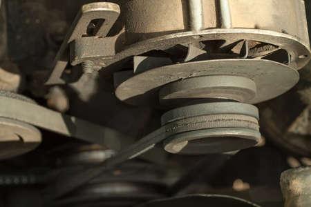 Old car engine. Alternator and belt drive. Reklamní fotografie
