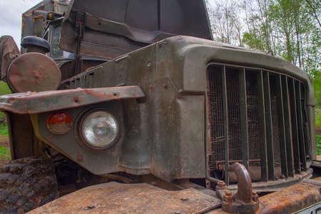 An old, big, rusty car - an all-terrain vehicle.