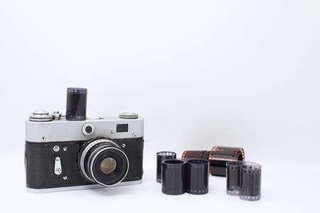 Film camera on a white background. Photographic film on a white background.