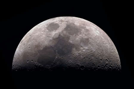 Moon, view through a telescope. The moon with craters. Real photos of space objects through a telescope. Natural background.