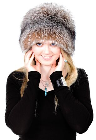 Blond Russian woman in fur hat on white background photo