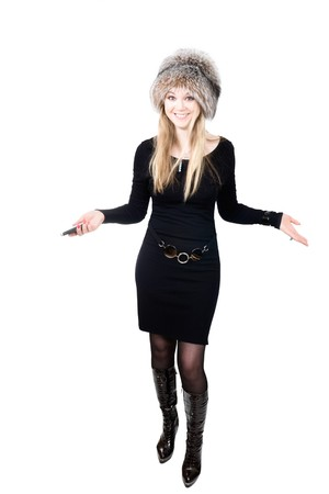 Blond Russian woman in fur hat speaking on mobile phone photo