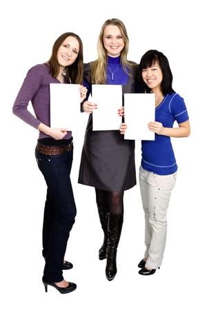 Three women holding white paper photo