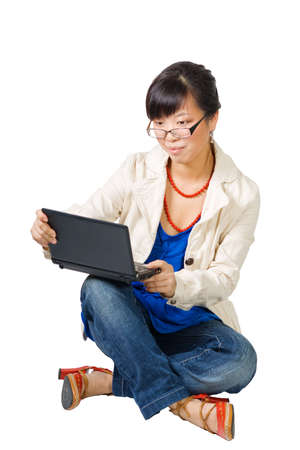 Asian woman with small laptop sitting on white background Stock Photo - 4540382