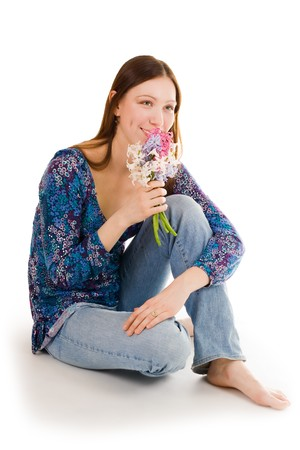 bulbar: Happy woman holding flowers close to face