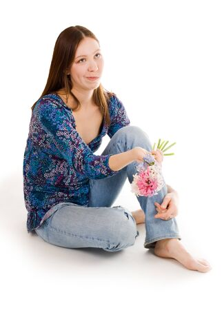 bulbar: Confused woman siting on the flor with flowers in hand looking straight