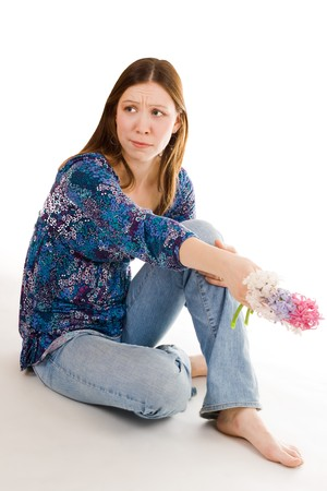 bulbar: Lonely woman siting on the flor with flowers in hand looking aside