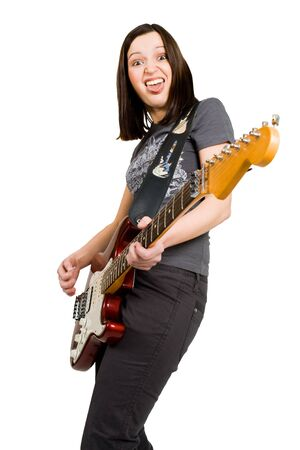 Woman standing playing on electric guitar photo