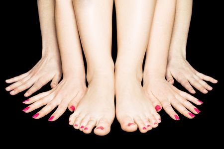 bare women: Close-up four hands and two legs on black Stock Photo