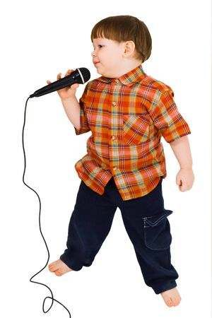 Kid singing, with black microphone on white background photo