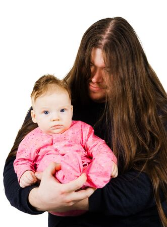 appease: Heavy metal father singing lulaby to his son hilding him in hands