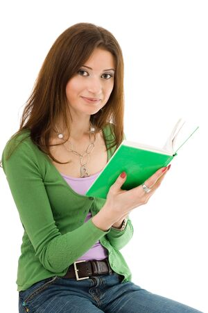 Woman in green holding book same color and looking to camera Stock fotó