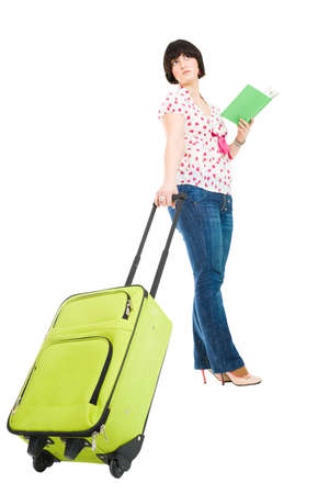 abroad: woman standing and holding suitcase and map traveling abroad Stock Photo