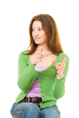 gesticulating: Young woman gesticulating with hands and looking aside Stock Photo