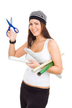 Joyful woman playing with scissors and holding package paper photo
