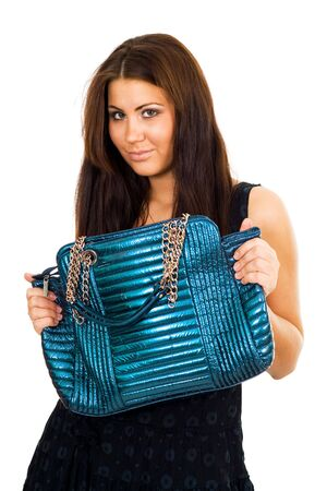handbag model: Young woman hoding big blue vivid purse with two hands and looking to camera slightly smiling