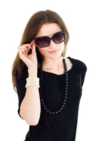 Attractive woman smiling in black gown wearing sunglasses