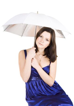 Upset young pretty woman holding umbrella in blue dress photo
