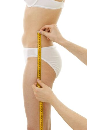 tailor measuring tape: Measuring womans hips size, with centimetre isolated, in generic underclothing Stock Photo