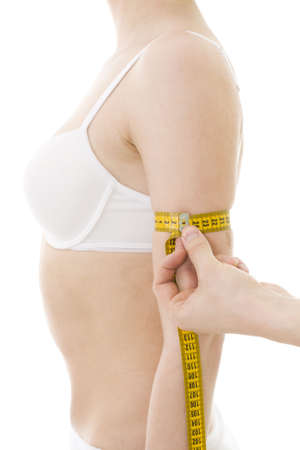 centimetre: Measuring womans arm size, with centimetre isolated, in generic underclothing Stock Photo