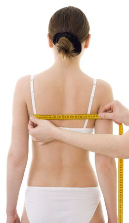 centimetre: Measuring womans  shoulder-blade distance, with centimetre isolated, in generic underclothing