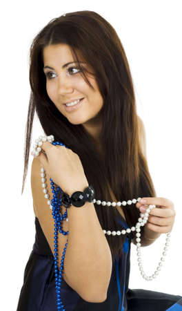 Young woman sitting holding beads and turning back photo