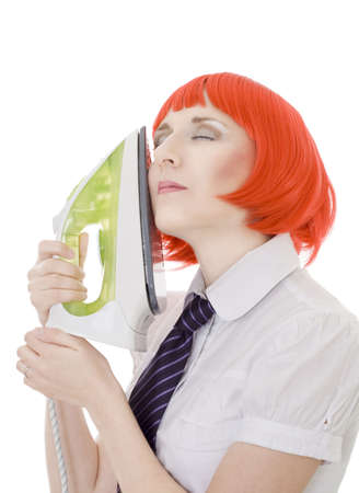 Calm  woman with iron in formal chemise red wig and tie photo