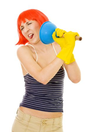 disgusted: Woman with disgusted cleaning tool standing in red wig