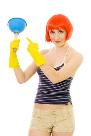 joyfull: Young happy woman pointing at blue vivid plunger wearing red wig and yellow gloves Stock Photo