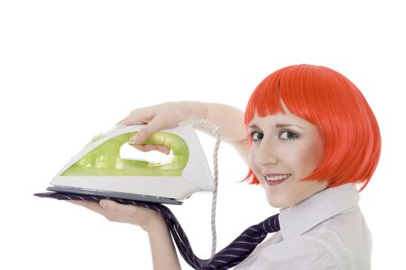 Smiling woman ironing tie smiling and looking to camera photo