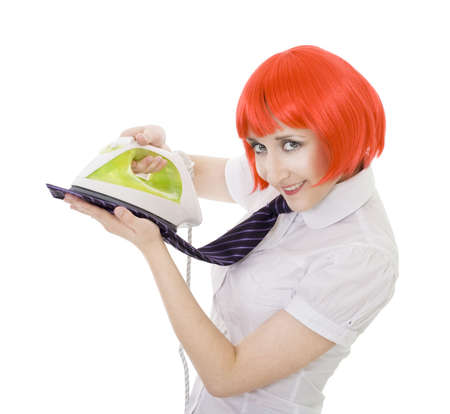 happy woman ironing tie smiling and looking to camera photo