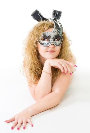 intriguing: intriguing woman laying and wearing mask Stock Photo